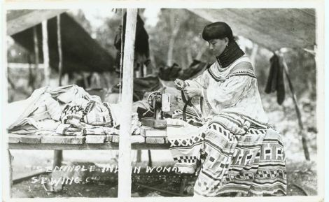 Seminole women sewing patchwork in her Chickee; photo courtesy of the Ah-Tah-Thi-Ki Museum