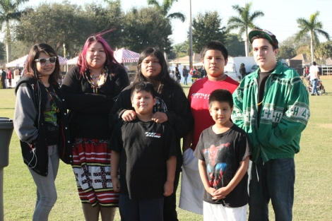 Youth wearing modern patchwork at Hollywood Reservation Christmas celebration